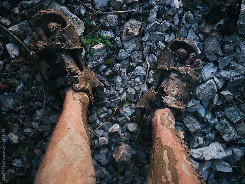 Sandals and legs dirty from mud by Martin Matej for Stocksy United