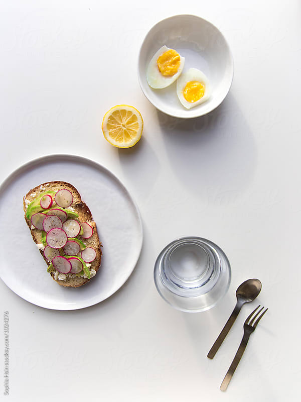 Radish on toast and hard boiled eggs by Sophia Hsin for Stocksy United