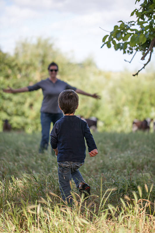 Mum and Toddler playing outdoors by Rowena Naylor for Stocksy United