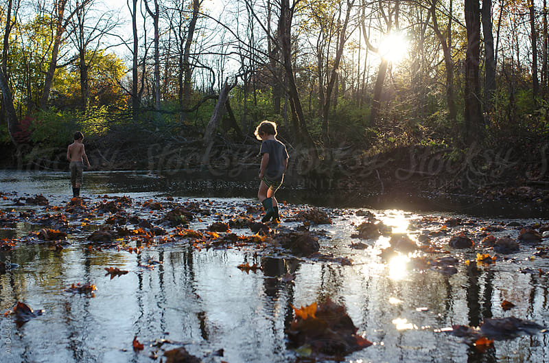 Boys Walk in a Creek by Ali Deck for Stocksy United