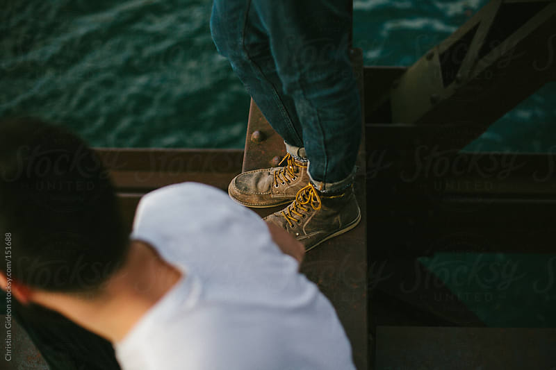 Boots on Bridge by Christian Gideon for Stocksy United