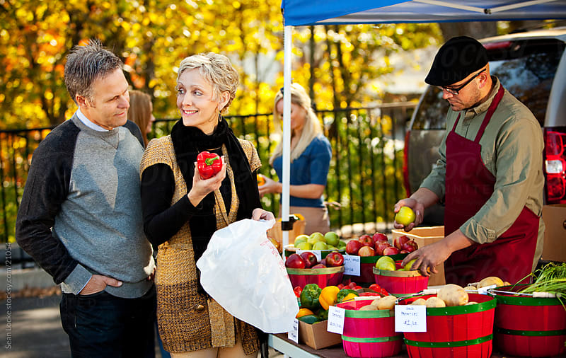 Farmer's Market: Couple Shopping at Market by Sean Locke for Stocksy United
