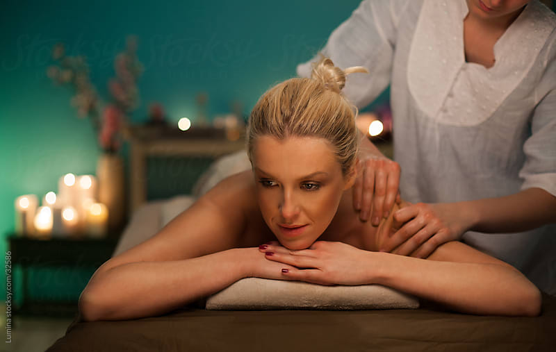 Woman Being Massaged by Lumina for Stocksy United