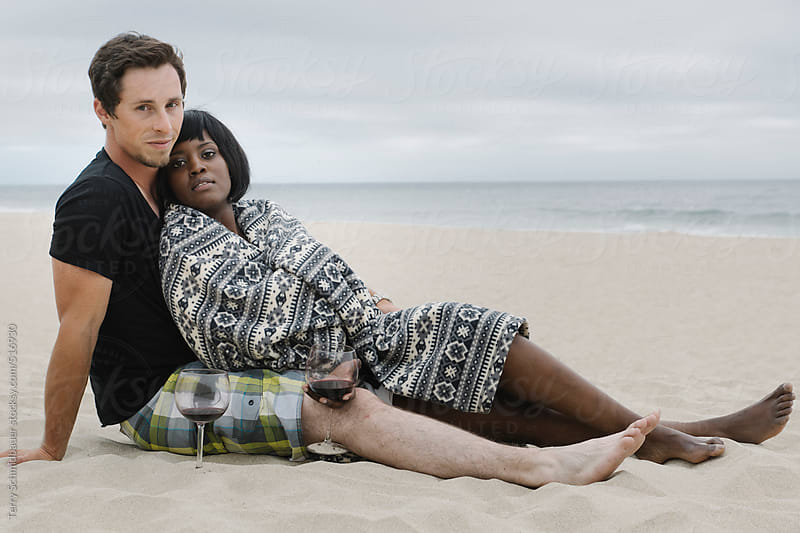 Young Couple at the Beach by Terry Schmidbauer for Stocksy United