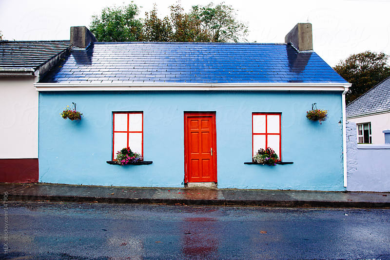 Exterior Blue and Red House by HEX. for Stocksy United