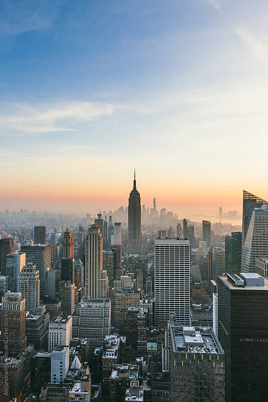 View of New York City at sunset with copy space. by Alejandro Moreno de Carlos for Stocksy United