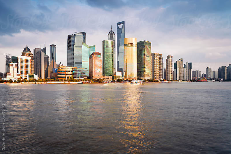 New Pudong skyline, looking across the Huangpu River from the Bund, Shanghai, China by Gavin Hellier for Stocksy United