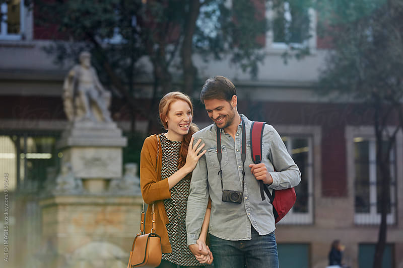 Happy Loving Couple Walking In City by ALTO IMAGES for Stocksy United