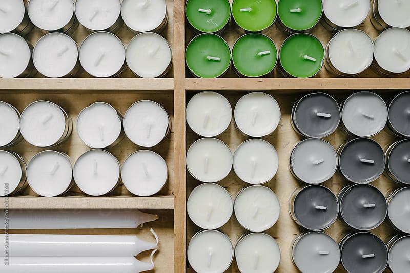 a good supply of tea light candles , overhead by Gillian Vann for Stocksy United