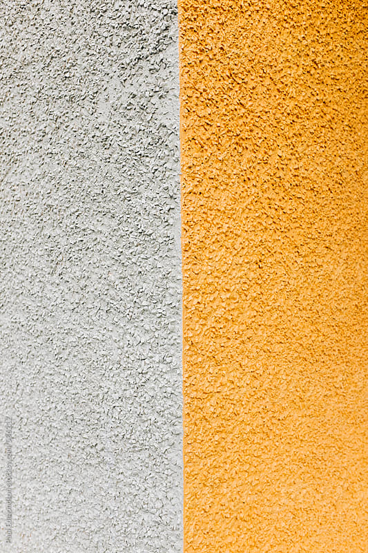 Corner of  colorfully painted building wall, close up by Paul Edmondson for Stocksy United