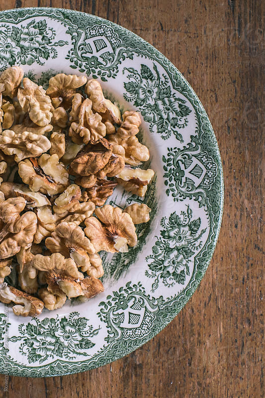 Plate of fresh walnuts by Rowena Naylor for Stocksy United