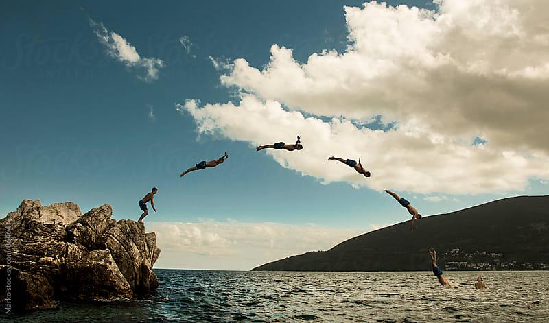 Man jumping into water by Marko Milovanović for Stocksy United