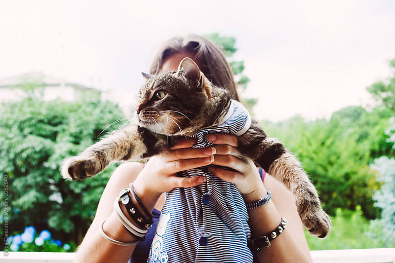 Woman holding a cat by Giada Canu for Stocksy United
