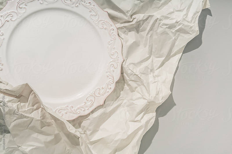 Plate Wrapped in Paper for Shipping by suzanne clements for Stocksy United