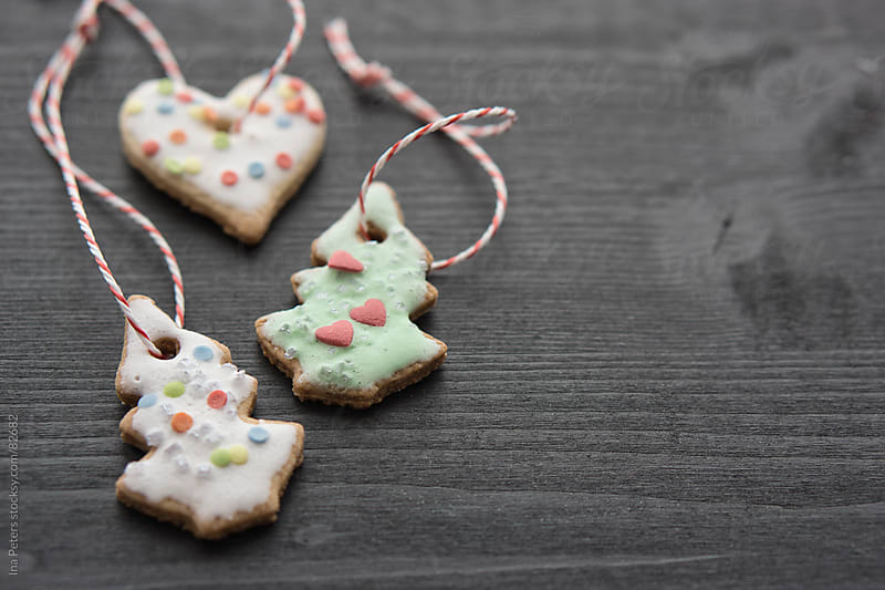 Homemade christmas cookies for tree decoration by Ina Peters for Stocksy United