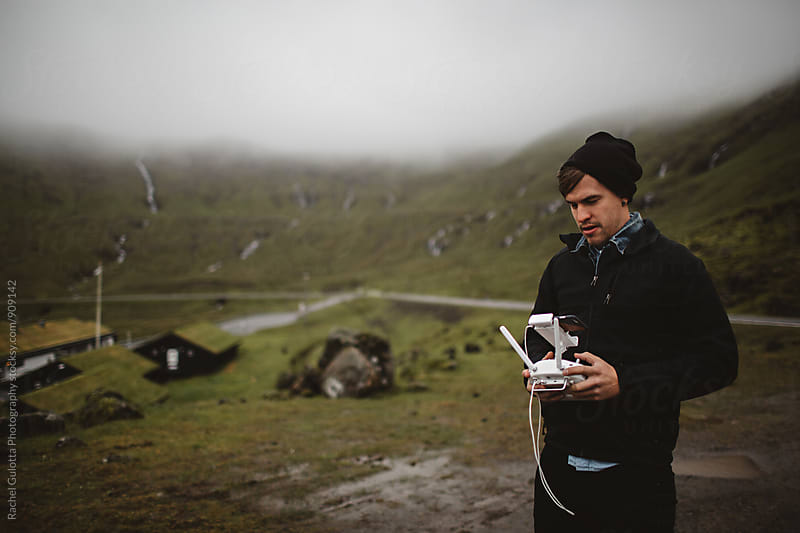 A Boy Flying A Drone in the Faroe Islands by Rachel Gulotta Photography for Stocksy United
