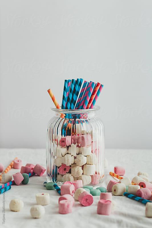 Marshmallows and straws in a jar by Tatjana Zlatkovic for Stocksy United