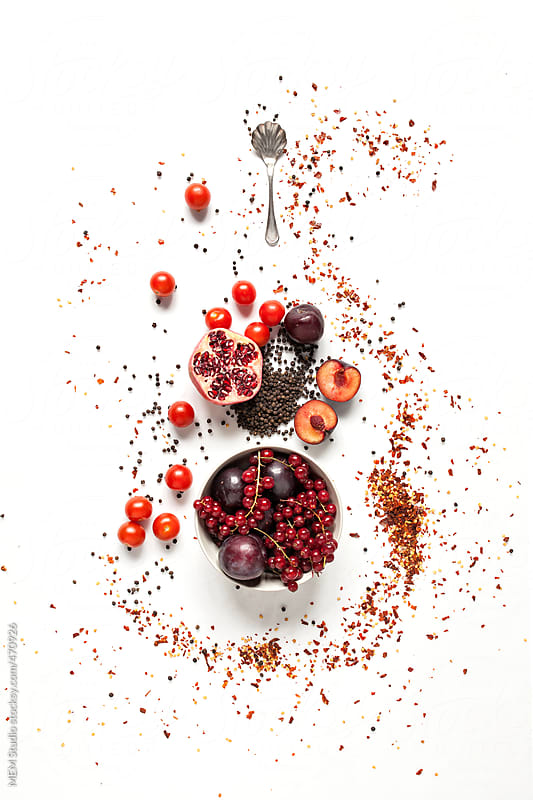 cherry tomatoes with prunes by MEM Studio for Stocksy United