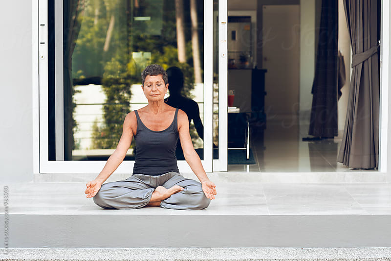 Senior Woman Meditating Outdoors by Lumina for Stocksy United