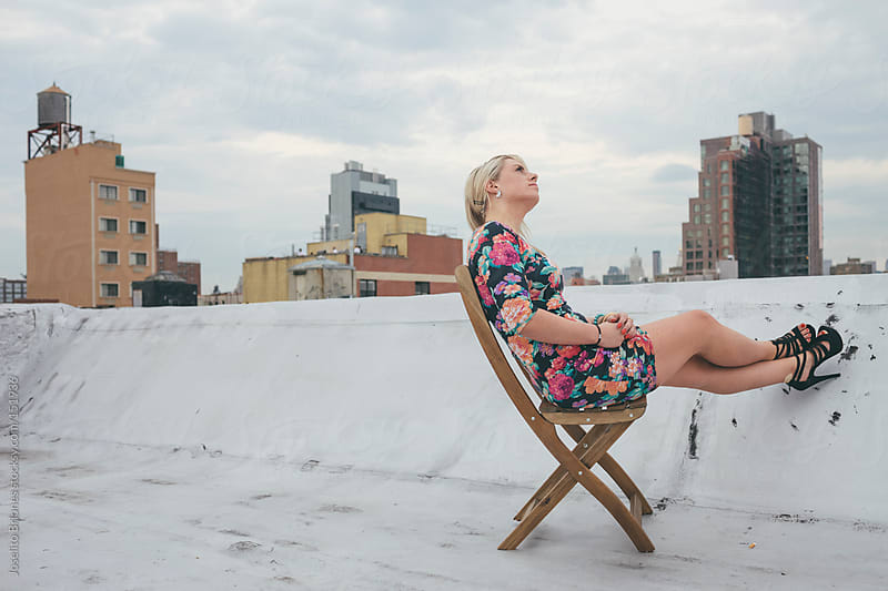 Portrait of a Caucasian Woman on a New York Rooftop by Joselito Briones for Stocksy United
