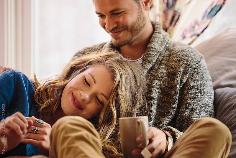 Couple relaxing and connecting at home by Trinette Reed for Stocksy United