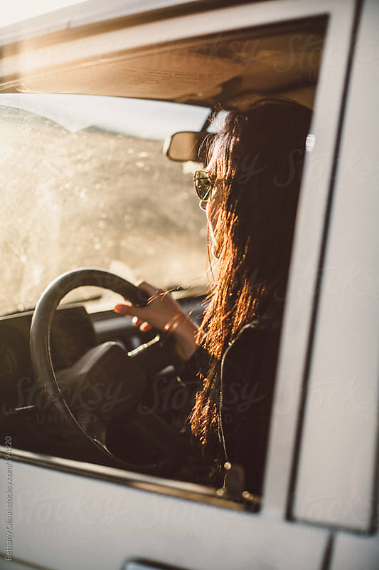 Driving in Sun by Bethany Olson for Stocksy United