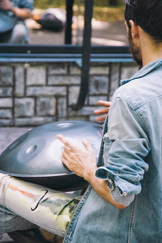 Musician playing handpan by T-REX & Flower for Stocksy United