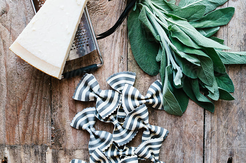 Striped pasta, sage, butter and parmesan. by Helen Rushbrook for Stocksy United