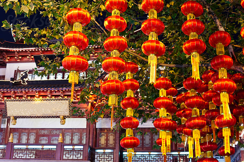 Lanterns hanging in Yuyuan Bazaar district at night, Shanghai, China by Gavin Hellier for Stocksy United