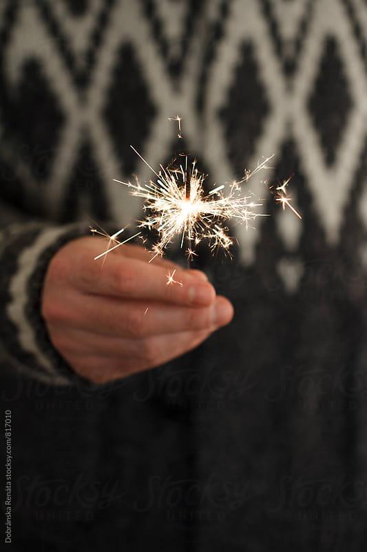 Man holding sparkler by Dobránska Renáta for Stocksy United
