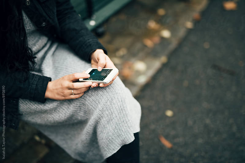 Woman using phone by Isaiah & Taylor Photography for Stocksy United