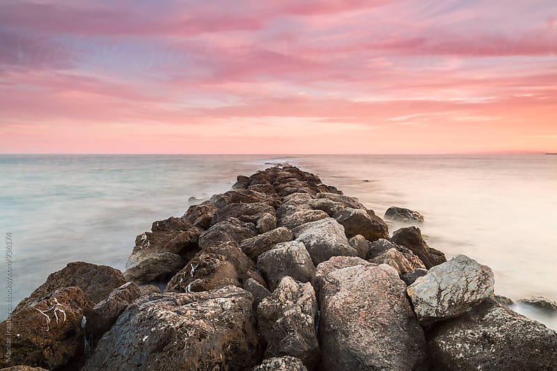 Rock pier at sunset by Marilar Irastorza for Stocksy United