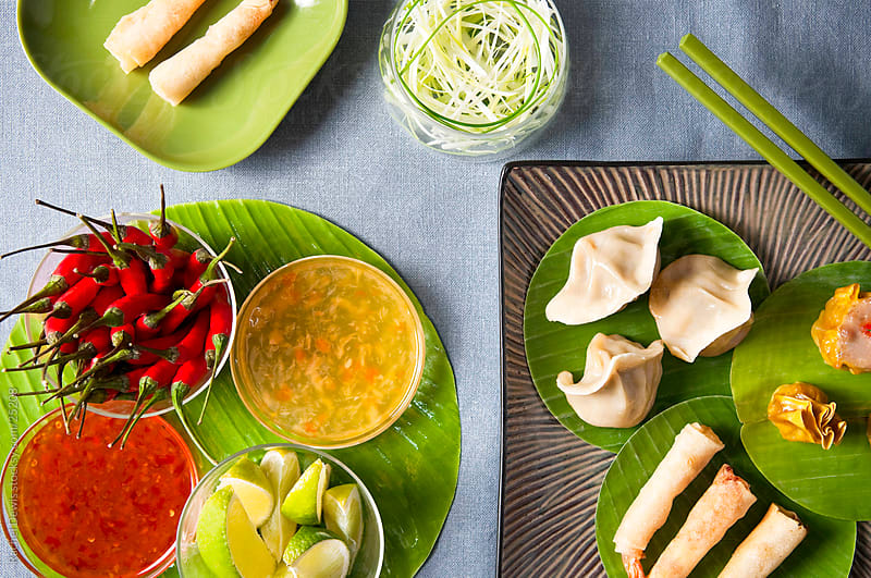 A platter of oriental finger food. by Rachel Dewis for Stocksy United