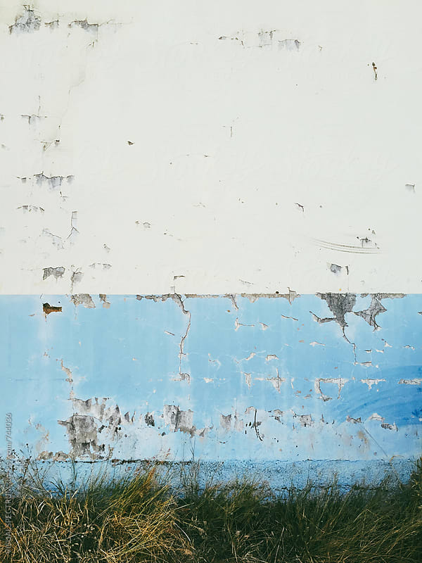 Shabby White and Light Blue Colored Wall Background by VISUALSPECTRUM for Stocksy United