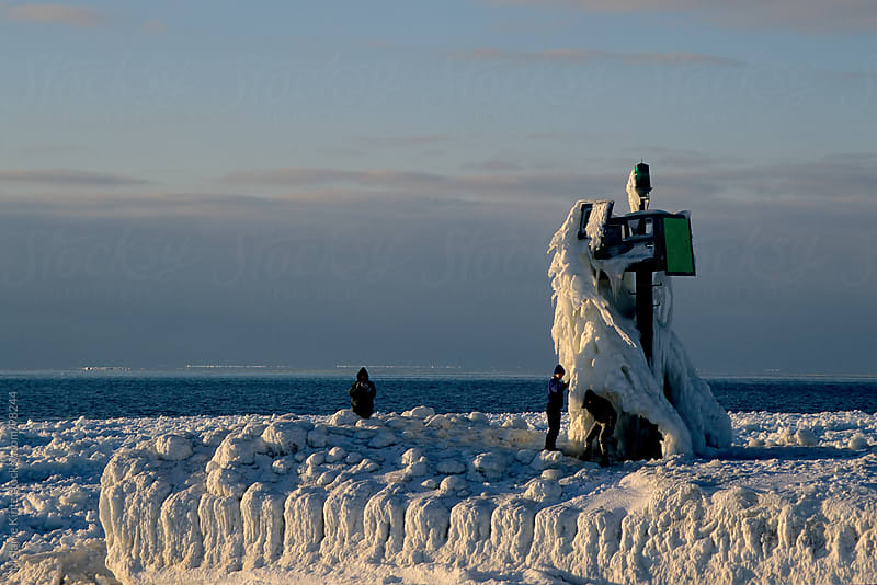Ice covered naval signal at Lake Michigan by Melanie Kintz for Stocksy United