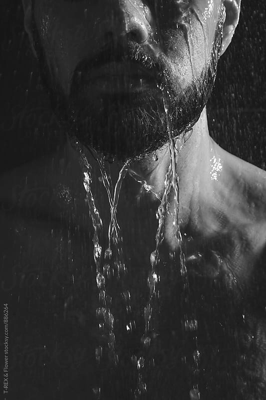 Close-up of man having shower by Danil Nevsky for Stocksy United