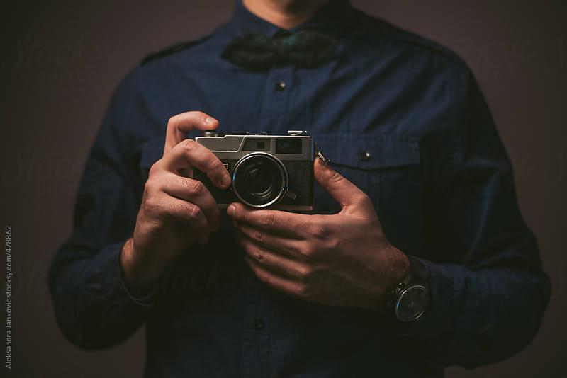 Man holding analog camera by Aleksandra Jankovic for Stocksy United