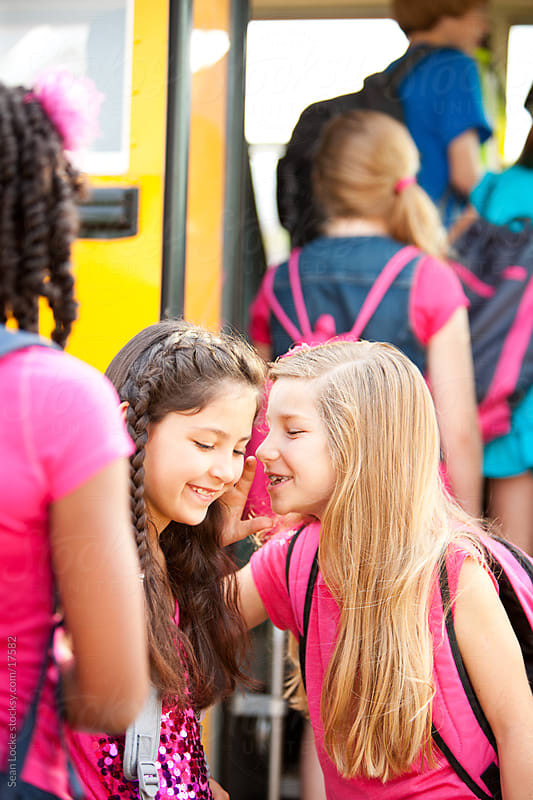 School Bus: Girls Telling Secrets Before School by Sean Locke for Stocksy United