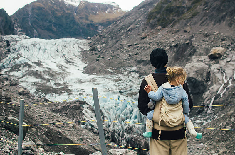 Father and daughter hiking to Fox Glacier by Dominique Chapman for Stocksy United