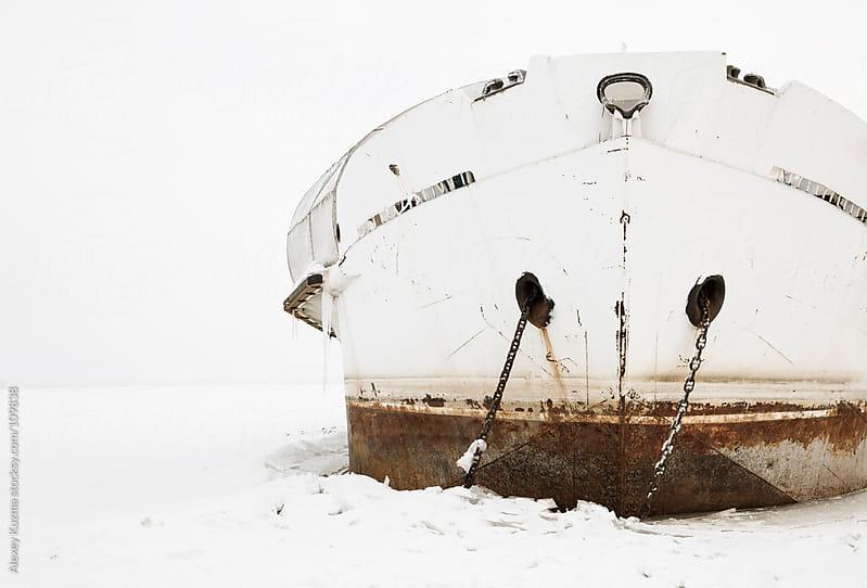 frozen ship by Alexey Kuzma for Stocksy United