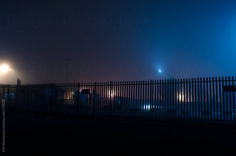 Illuminated Fence by Neil Warburton for Stocksy United