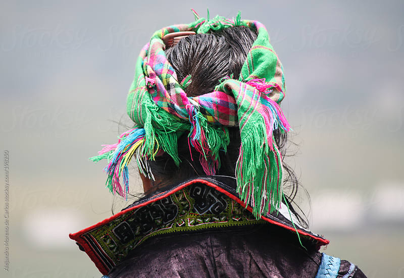Traditional tribal woman wearing a colourful headscarf from behind - Sapa, Vietnam, Asia by Alejandro Moreno de Carlos for Stocksy United