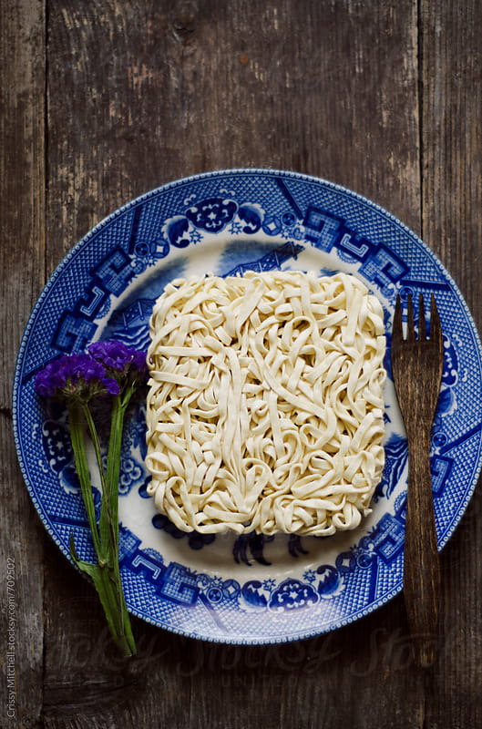 uncooked instant noodles by Crissy Mitchell for Stocksy United