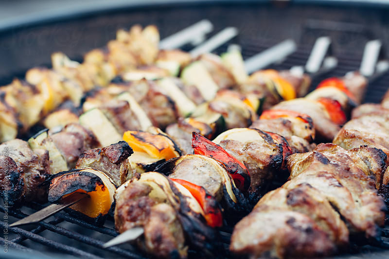 Various grilled meat on skewers by Gabriel (Gabi) Bucataru for Stocksy United