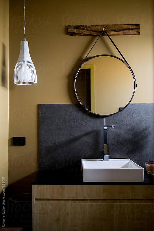 Styled bathroom with dark feel by Rowena Naylor for Stocksy United