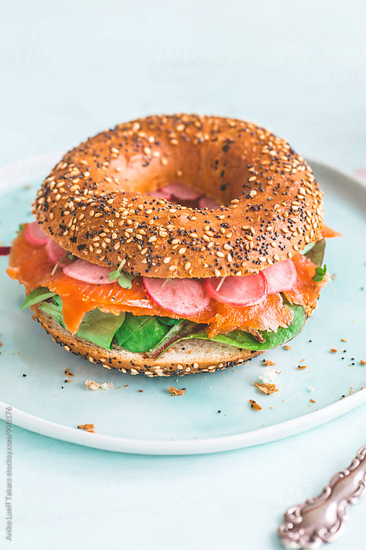 Bagel with smoked trout and pickled radish by Aniko Lueff Takacs for Stocksy United