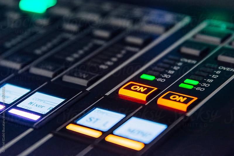 Buttons on an audio mixer board by Gabriel (Gabi) Bucataru for Stocksy United