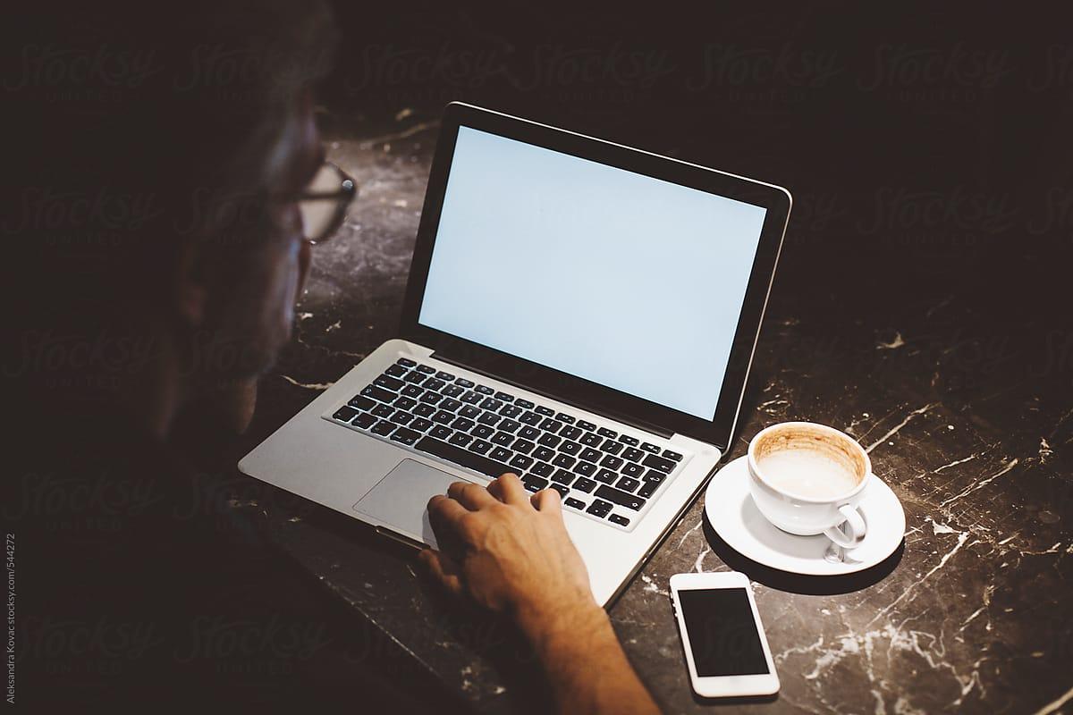 Man typing on laptop by Alexandra Bergam - Laptop, Man - Stocksy United