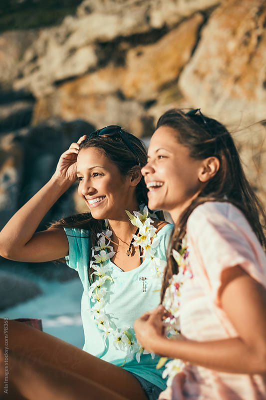Two Girls Having Fun on the Beach by Aila Images for Stocksy United
