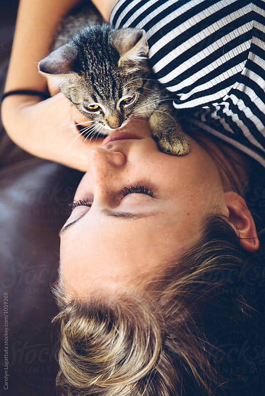 A girl and her kitten by Carolyn Lagattuta for Stocksy United